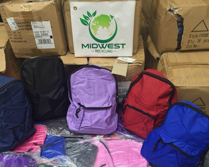 Local Recycling Company Donates to 490 Backpacks filled with Supplies