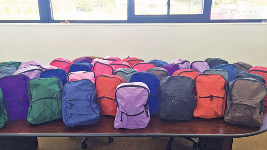Midwest Recycling leads backpack donations across metro Detroit